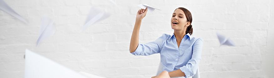 Woman throwing paper aeroplanes.